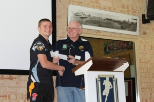 Kieran Crowe accepts his award fro WARL Past Players President, John Moore