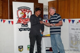 "Heremaia Hohepa from the South West Warriors receiving his ""Junior Club Person"" award from John Moore"